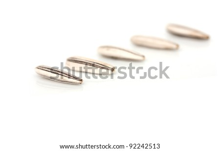 Extreme close-up image of sunflower seeds studio isolated on white background