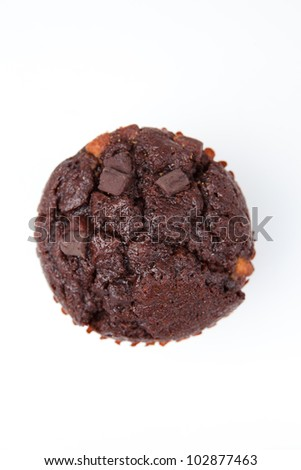 Extreme close up of a chocolate muffin against a white background