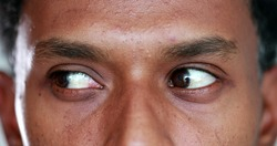 Extreme close-up of african american man eyes looking up , down and sideways