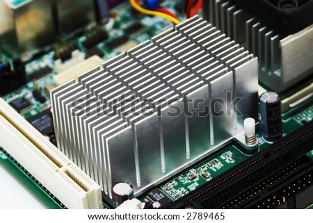 extreme close-up of aluminum radiator installing on motherboard chipset - stock photo