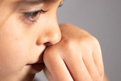 Extreme close up of child touch's her Nose - concept showing to prevent and Avoid touching your Nose. Protect from COVID-19 or coronavirus spreading or outbreak - Don t Touch Your Nose