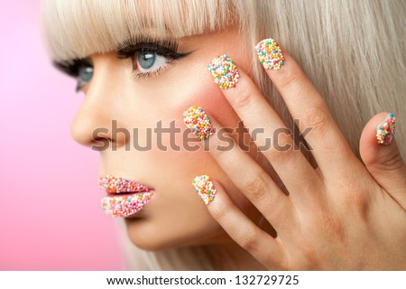 Extreme close up of fantasy make up with sugar sprinkle dots.