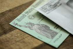 Extreme close-up of Federal coronavirus stimulus check provided to all Americans from the United States Treasury in 2020 and 2021, showing the statue of liberty.