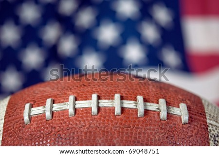 extreme close up of football with flag background