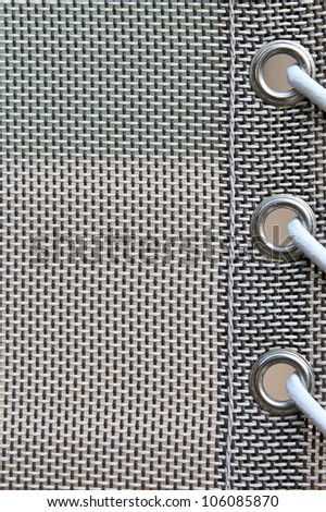 extreme close up of mesh fabric, grommets and string / Dream Weaver - stock photo