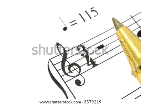extreme close-up of music note and ballpoint pen tip against white background, focus is set on treble clef
