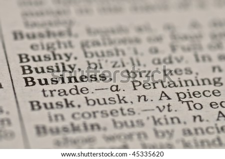Extreme close up of the word BUSINESS found inside a dictionary