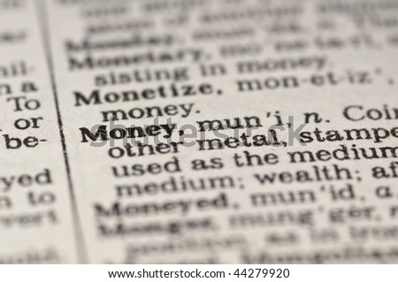 Extreme close up of the word MONEY found inside a dictionary