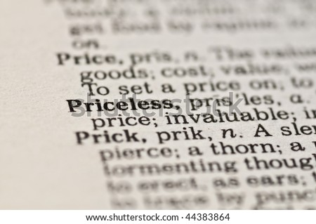 Extreme close up of the word PRICELESS found inside a dictionary
