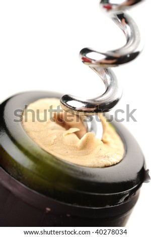 Extreme close-up of wine bottle and cork screw