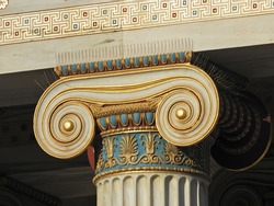 Extreme close up photo revealing great detail in iconic ancient Greek style golden pillars of Academy of Athens, Attica, Greece