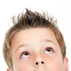 Extreme close up portrait of boy looking up.Isolated on white.