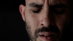 Extreme close up portrait of sad and depressed man. Caucasian man crying face. High quality photo