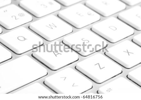 extreme closeup of a modern silver keyboard