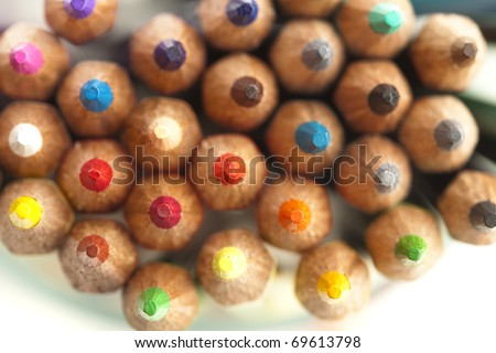 extreme closeup of a various crayons on white background