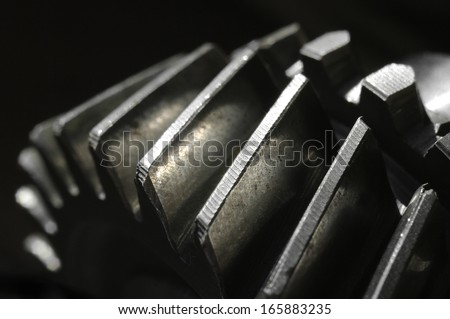 Extreme closeup of an old gear from a car gear box.(Shallow DOF) #165883235