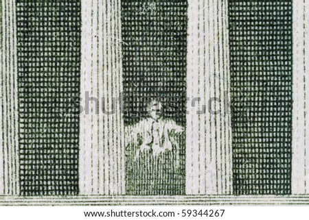 Extreme closeup of the Lincoln Memorial on the five dollar note