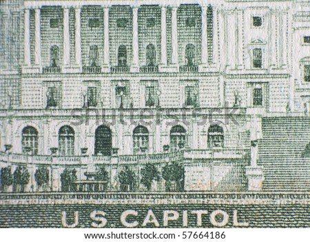 Extreme closeup of the US capitol on the fifty dollar note