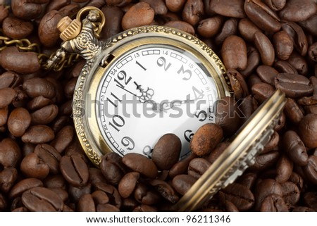 Extreme closeup Pocket watch in coffee beans
