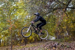 Extreme cycling concept: mountain bike rider makes a jump. Cycling, MTB. Downhill.