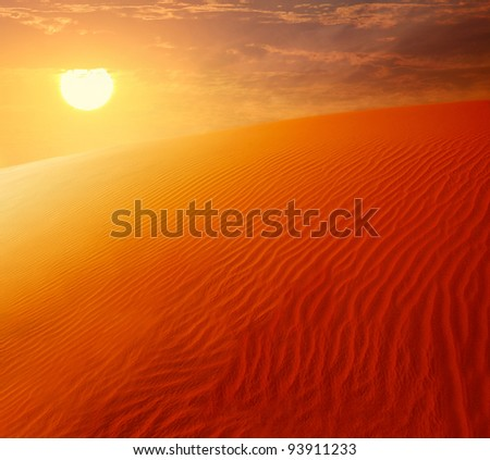 Extreme desert landscape with orange sunset, beautiful sandy background with hot sunlight, wilderness, beauty of nature, United Arab Emirates, Dubai
