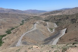 Extreme difficult road pass on adventure car road trip in moroccan landscape countryside and scenic hills of african Atlas mountains with curvy winding zigzag street near Marrakech, Morocco, Africa.