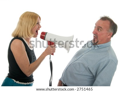 stock photo : Extreme domestic argument with wife shouting commands through a megaphone at her fearful husband.