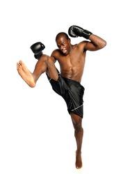 Extreme Fighting Athete kicking isolated on a white background