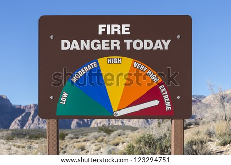 Extreme fire danger today sign with Mojave desert background