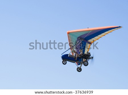 Extreme flight on deltaplane in a blue sky