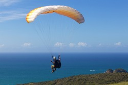extreme glider over the beach