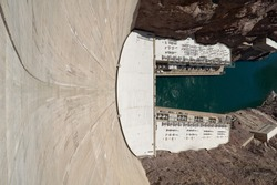 Extreme High Angle View Looking Down Wall of Hoover Dam, a Popular Tourist Destination and Hydroelectric Dam, Toward Colorado River in Black Canyon, Between Nevada and Arizona, USA