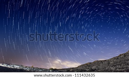Extreme long exposure image showing star trails around the Polar Star or Polaris.