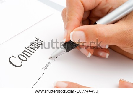 Extreme Macro Close up of female hand signing a contract.