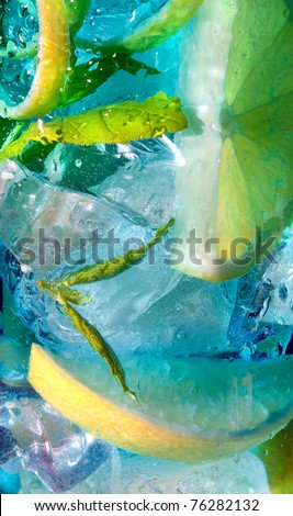 Extreme macro closeup of a blue cocktail drink with lemon slices