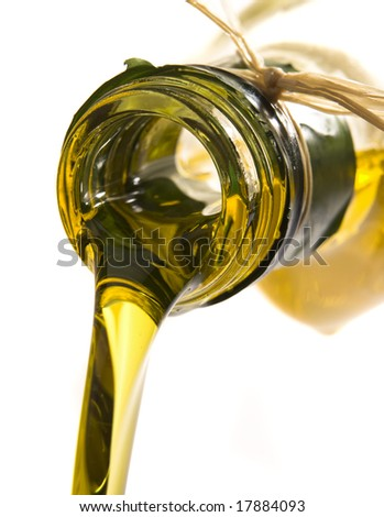 Extreme macro of olive oil poured from an original bottle isolated on white background