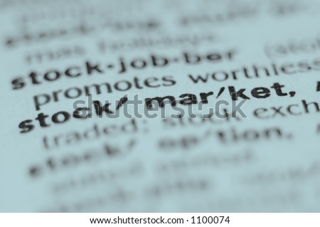 Extreme macro or close up of the word STOCK MARKET. Very shallow depth of field is intentional and shows only the word stock market in focus.