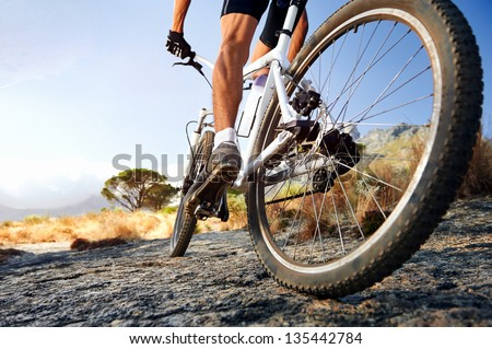 Extreme mountain bike sport athlete man riding outdoors lifestyle trail