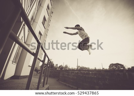 extreme Parkour training in an urban environment #529437865