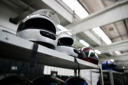extreme sport helmets on the shelf with white background