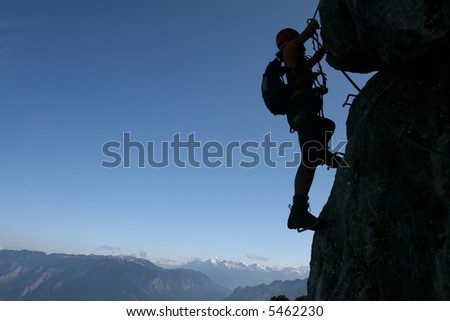 Extreme sport - silhouette of a climber