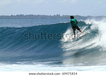 Extreme sport surfer on perfect wave