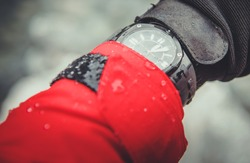 Extreme Sports and Expedition Timepiece on Mountain Hiker Wrist. Ultimate Analog Quartz Watch in Extreme Weather Conditions. Water Resistant.