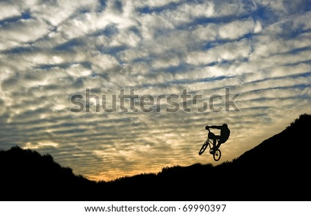 Extreme sports bike trials silhouette against beautiful sunset