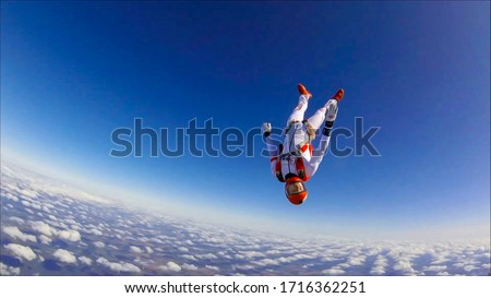 Extreme sports catapult parachutist. The sky is a working environment for a skydiver.Sports adrenaline. Beautiful views from the height of bird flight. ストックフォト ©