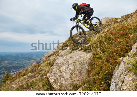 Free Man Riding A Mountain Bike In Downhill Style At Sunrise