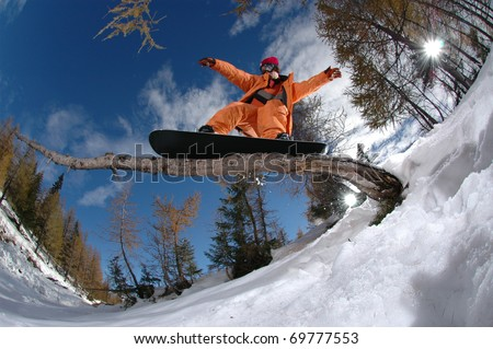 Extreme sports snowboarder jumping