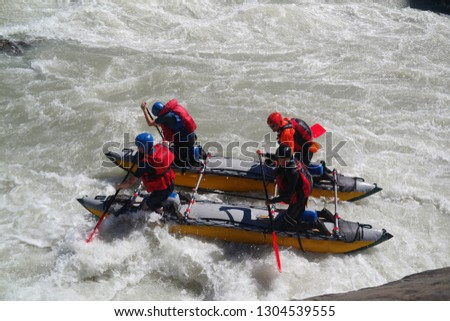 """extreme sportsmen rafters on catamarans pass the dangerous turbine threshold """"Turbine"""". Altai Republic, Chuya River, Russia. Clean air of Altai and the beauty of Siberia"""