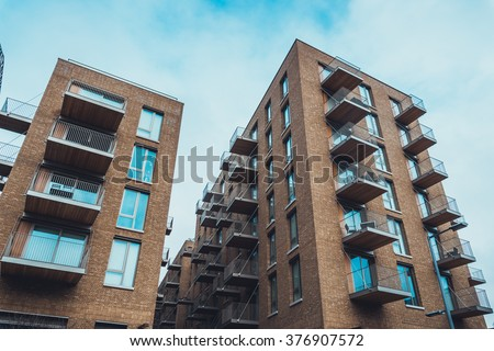 Detail · Extreme Wide Angle View Of Tall Brick Residential Apartment  Buildings With Tiny Balconies And Long Windows