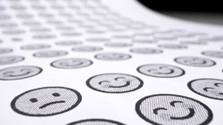 extremely close-up, detailed. smilies background. one cheerful smile among many sad ones.